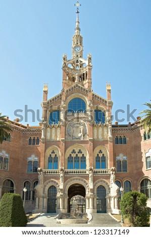 Entrance of the former Hospital of the Holy Cross and Saint Paul, Hospital de la Santa Creu i Sant Pau. The famous building, designed in the catalan modernisme, is a UNESCO World Heritage Site - stock photo