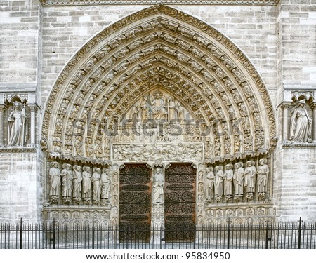 Entrance of the Notre Dame in Paris - stock photo