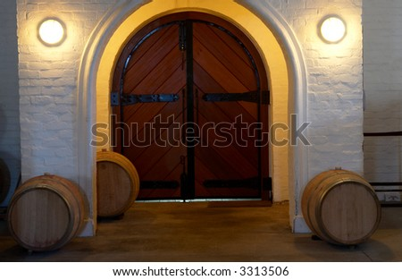 Entrance of the Plaisir de Merle wine cellar with French Oak barrels with wine surrounding it in Franschhoek, Western Cape, South Africa - stock photo