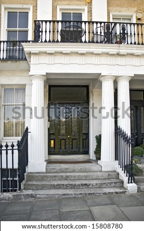 entrance, pediment and steps of English Regency house - stock photo