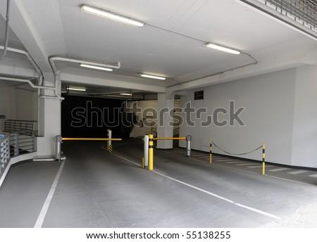 Entrance ramp to underground parking garage. - stock photo