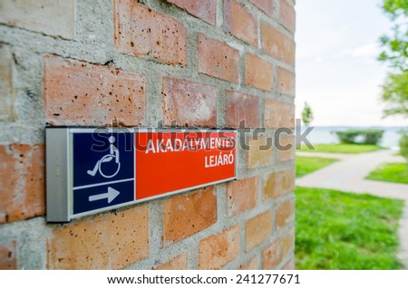 Entrance sign for handicapped persons, written in hungarian language - stock photo
