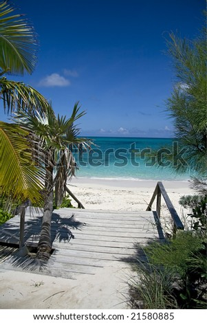 Entrance to a beautiful tropical beach with clear green water. - stock photo