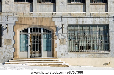 Entrance to a Dilapidated Warehouse - stock photo