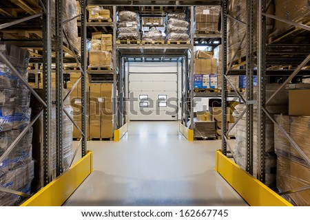 Entrance to a huge warehouse with metal rack - stock photo