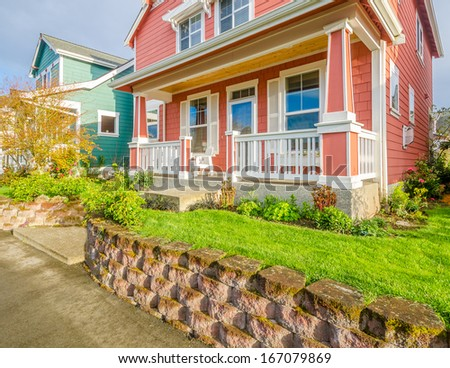 Entrance to a luxury house with an attractive front garden. - stock photo