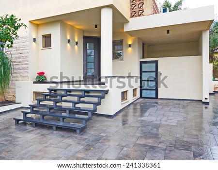 Entrance to a modern Mediterranean house with metal and stone elements - stock photo