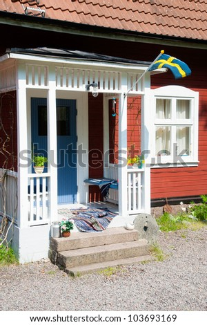 Entrance to a red wooden house in Sweden. summer atmosphere, typical scene - stock photo