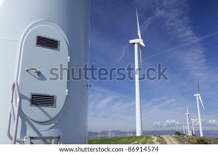 entrance to a windmill with cloudy sky - stock photo