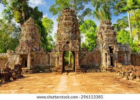 Entrance to ancient Preah Khan temple in Angkor. Siem Reap, Cambodia. Mysterious gopura on woods background. Angkor is a popular tourist attraction.