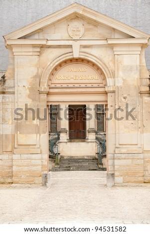 Entrance to famous archiepiscopal Palais du Tau im Reims, France - stock photo