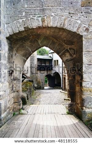 entrance to gothic castle - kost castle - czech republic - stock photo