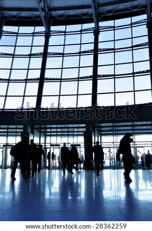 Entrance to modern building and people in motion blur - stock photo