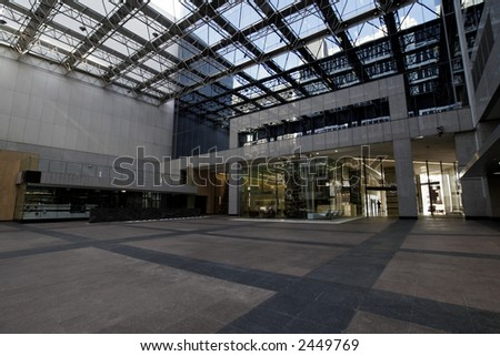 Entrance To Modern Urban Office Building With Glass Roof, Ceiling