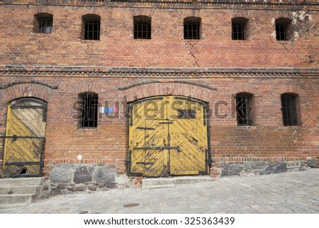 Entrance to old abandoned warehouse - stock photo