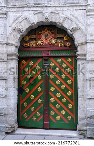 Entrance to the Brotherhood of Blackheads building in Tallinn, Estonia, with St Maurice image above the green door  - stock photo