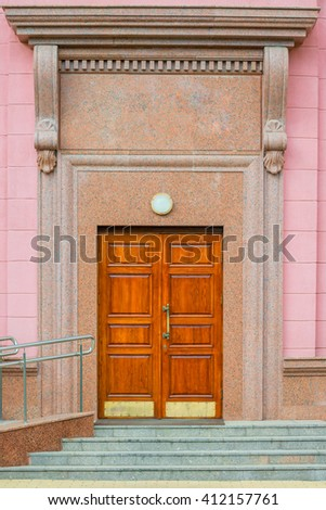 entrance to the building with wooden door vertical shot