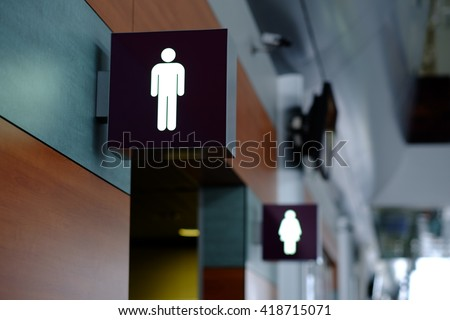 entrance to the male and female toilet. Sign in airport - stock photo