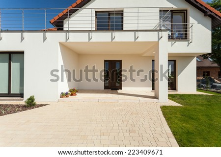 Entrance to the modern house during sunny day - stock photo