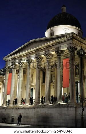 Entrance to the National Gallery, Trafalgar Square, London, England, UK, illuminated at night - stock photo