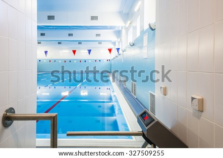 Entrance to the pool,  with turnstile. - stock photo