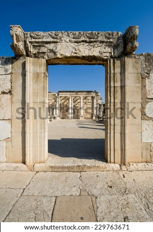 Entrance to the synagogue in the small town Capernaum on the coast of the lake of Galilee.  According to the bible this is the place where Jesus taught - stock photo