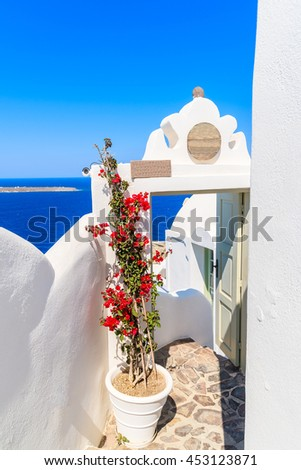 Entrance to typical restaurant in Oia village with beautiful sea view, Santorini island, Greece