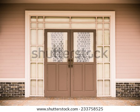 Entrance vintage House  leading to a double glass paned front door with two large front lanterns. split toning color effect - stock photo