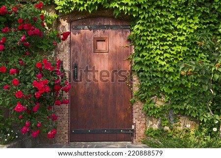 entrance wooden door and roses