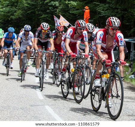 ENTREMONT,FRANCE,JUL 13 : Cyclists from Katusha Team in front of peloton during the climbing the road to mountain pass Granier in the 12 stage of the 2012 edition of Le Tour de France on July 13 2012. - stock photo