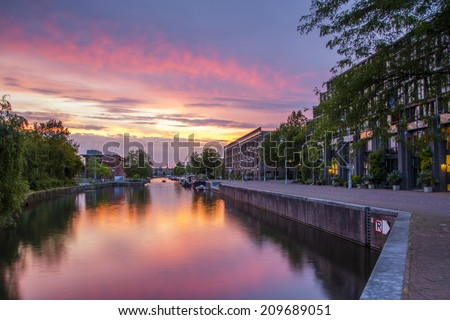 Entrepotdok canal, Amsterdam 6. Shortly after the sun had set on Nieuwevaart canal, I moved to another location nearby- a more sheltered waterway where the reflections were beautiful. - stock photo