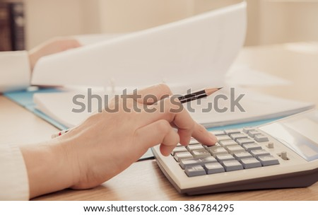 entrepreneur calculation and reviewing investment plan. concept of accounts, calculated, planning. - stock photo