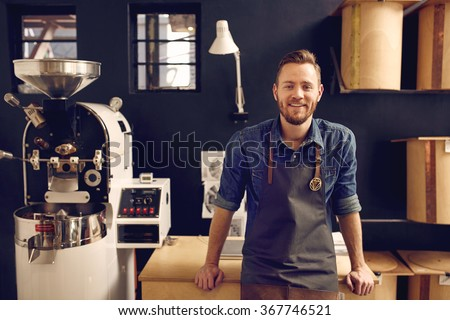 Entrepreneur in his modern coffee roastrery and distribution spa - stock photo