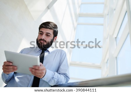 Entrepreneur reading information on digital tablet