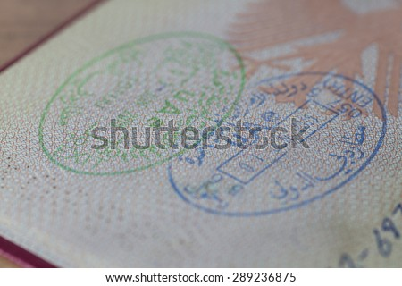 Entry and Exit Stamp of the United Arab Emirates in a german Passport - stock photo