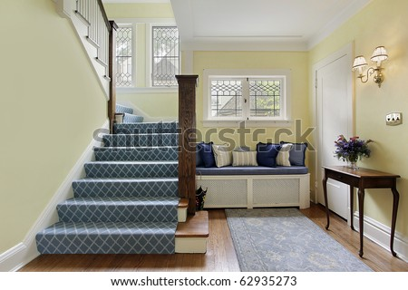 Entry area of luxury home with yellow walls - stock photo