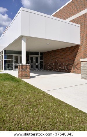 entry doors and sidewalk by a new school - stock photo