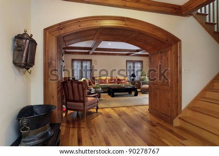 Entry into luxury living room with arch - stock photo