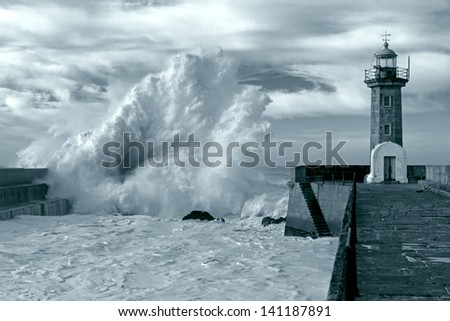 Entry of Douro River harbor during a storm - toned black and white - stock photo