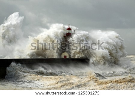 Entry of Douro River harbor on the first big storm of the year; Wind gusts reach 140/150 Km; photo taken on Jan. 19, 2013. - stock photo