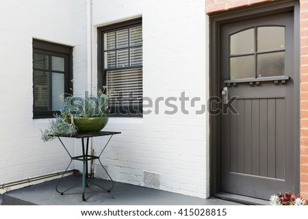 Entry porch and front door of an art decor style apartment in Australia - stock photo