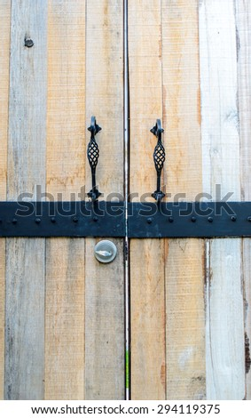 Entry to house through two wooden doors
