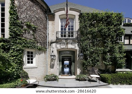 Entry way of mansion with lake view - stock photo
