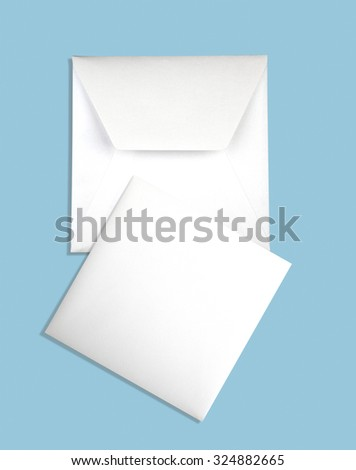 Envelope and card isolated on azure background