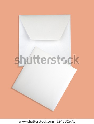 Envelope and card isolated on pink background - stock photo