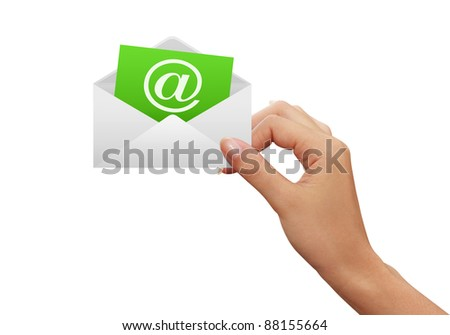 Envelope and e-mail in the hands of women - stock photo