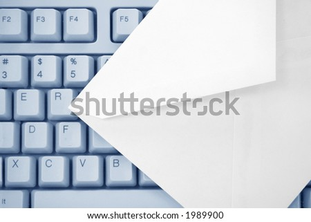 envelope and keyboard, concept of email - stock photo