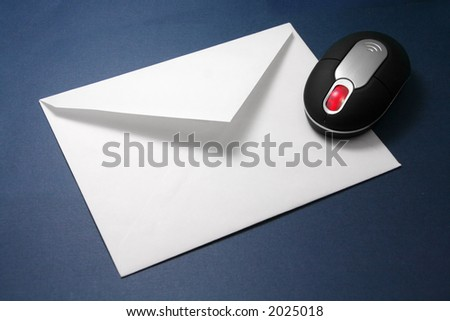 envelope and wireless mouse, concept of email - stock photo