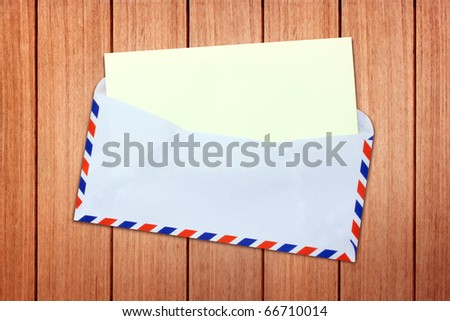 Envelope, letter with blank Brown paper on old wood - stock photo