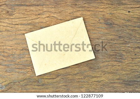 Envelope made by Mulberry paper on wooden texture - stock photo